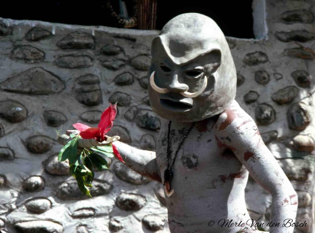 Mudman with red flower