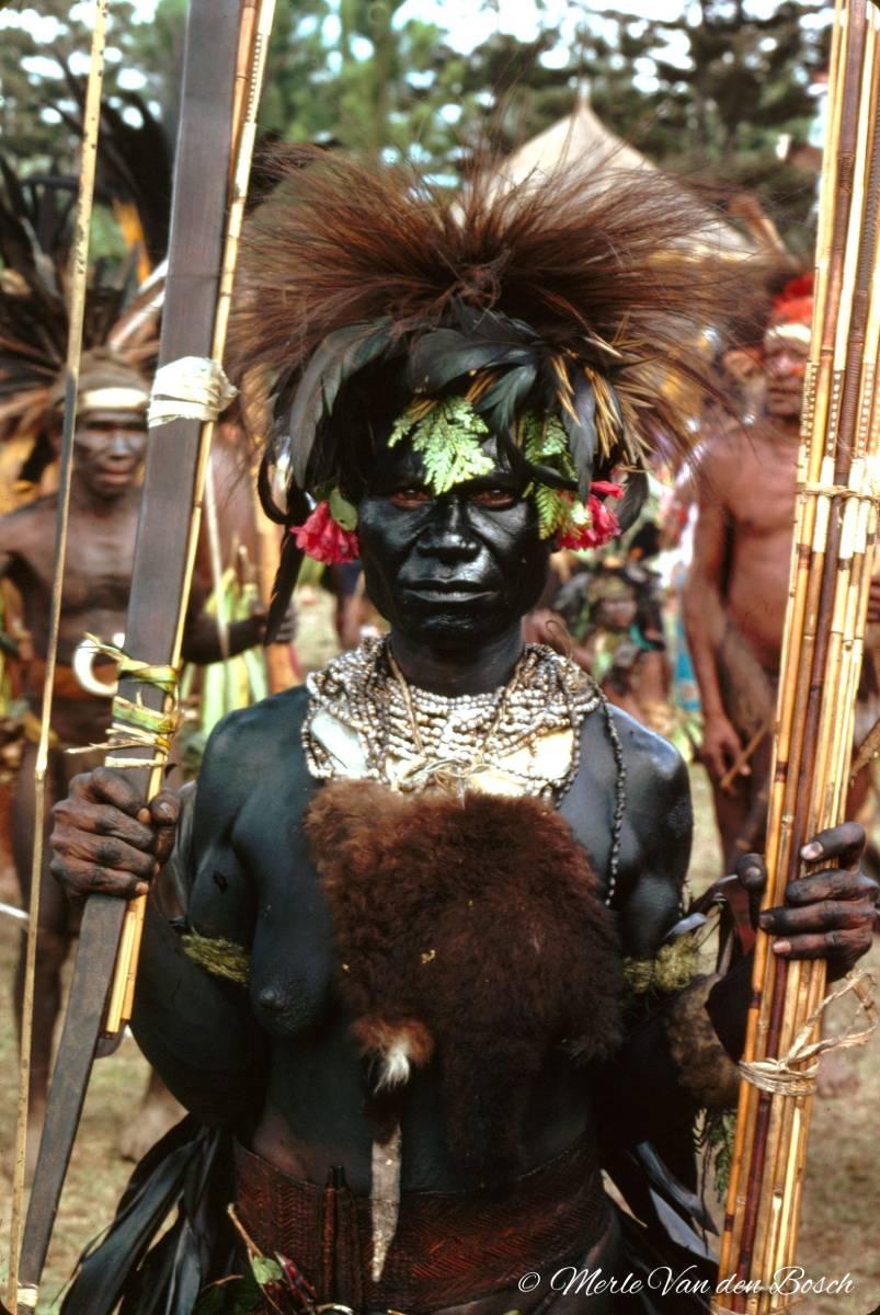 Woman all black & sticks