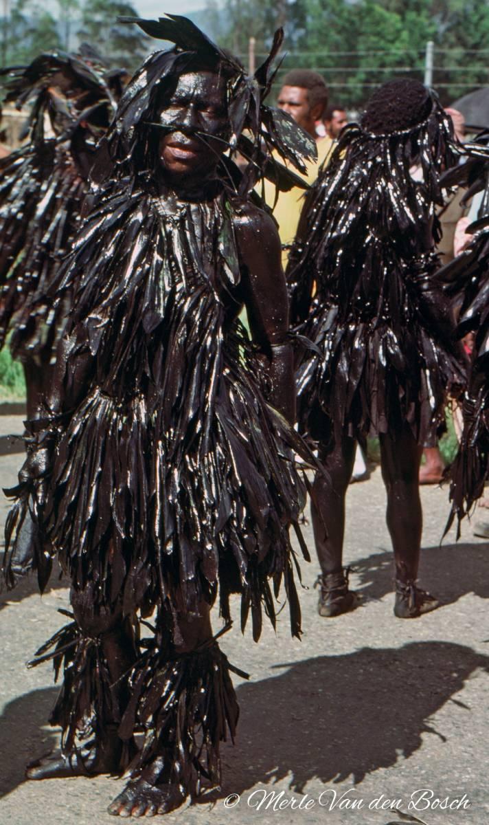 Woman in black leaves